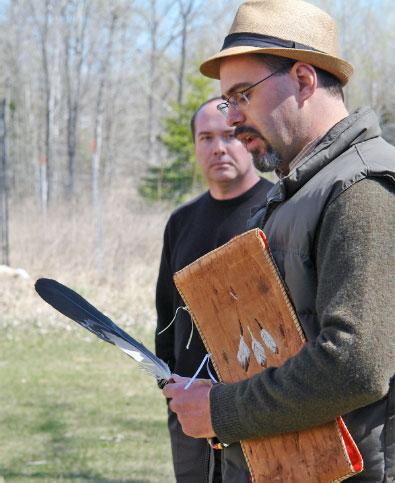 Scott Herron, Anishinaabe ethnobotanist, with eagle feather leading the workshop's closing Talking Circle